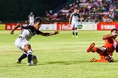 Sisaket Thailand-may 28: Nurul Sriyankem Of Chonburi Fc. (white) In Action During Thai Premier Leagu