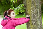 Mongolian Woman Training With A Tree