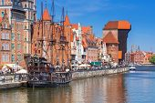 GDANSK, POLAND - 20 MAY: The medieval port crane over Motlawa river on 20 May 2014. This port crane built between 1442 and 1444 is the symbol of Gdansk and the oldest surviving port crane in Europe.