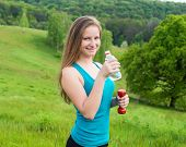 Sport, exercise and healthcare - sporty girl with water bottle. Young beautiful woman drinking water