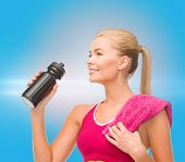 fitness and diet concept - sporty woman with special sportsman bottle and towel