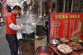 Small Outdoor Eatery In The Open Air, Shanghai, China.