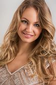 Beautiful, curly woman with wide smile