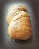 Freshly baked traditional bread on dark background