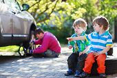 foto of four-wheel  - Happy family of three - JPG
