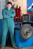 Mechanic In Garage