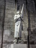 PARIS, FRANCE - AUGUST 25 2013: Joan of Arc statue inside the Notre Dame Cathedral