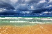Storm clouds over a sandy beach