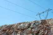 Electric Pylon Over Cliff Face
