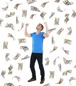 stock photo of dancing rain  - Happy man enjoying rain of money - JPG