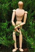 Wooden pose puppet outdoors