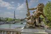 Eiffel Tower View And A Statue From Pont Alexandre Iii