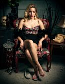 Beautiful Young Blond Woman Sitting In Chair