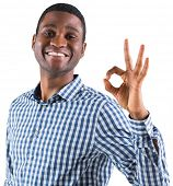 Happy businessman making ok sign on white background