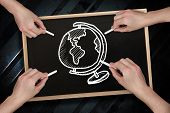 Composite image of multiple hands drawing globe with chalk against blackboard