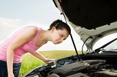 Woman Looking Under Hood Car