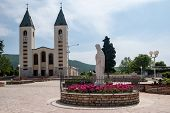 stock photo of rosary  - Pilgrimage church and Virgin Mary statue in Medjugorje - JPG