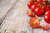 stock photo of wood pieces  - red cherry tomatoes on a white wood background - JPG