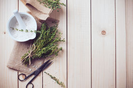 foto of text-box  - Cozy rustic home kitchen still life dried herbs thyme salt in white mortar old wooden box and vintage scissors on a table background - JPG