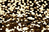Christmas New Year Gold Glitter background. Holiday abstract texture