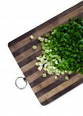 Green chopped onions on a cutting board