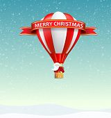 Merry christmas from Santa Claus traveling on hot air balloon
