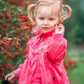 little cute girl on a warm autumn day on the walk