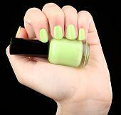 Nail polish in hand, close-up