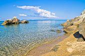 Sandy beach with rocks near small greek village Toroni in Sithonia