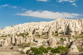 Spectacular teeth-like rock formation and old christian caves near Goreme, Cappadocia, Turkey