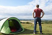 Rear View Of Man Camping And Admiring View