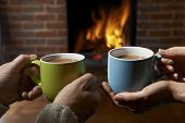pic of hot couple  - Couple With Hot Drink Relaxing By Fire - JPG