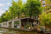 City View Of Amsterdam Canal And Houseboat, Holland, Netherlands.