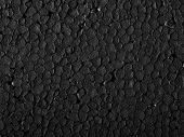 pic of thermoplastics  - Full frame closeup of a black Polystyrene surface - JPG