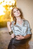 foto of blouse  - Elegant glamour woman wearing brown skirt and blouse outdoor in the park at sunset - JPG