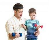 middle-aged man and kid do exercise with dumbbell