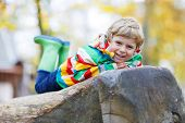 Adorable Child Boy Having Fun On Autumn Playground