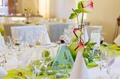 Elegant Table Set In White And Green With Apples For Wedding Party In A Castle