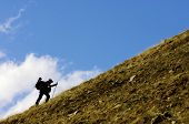 mountaineer to climb the crest of a hill in the Pyrenees