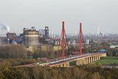 Steel Plant And River Bridge