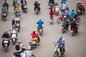 HANOI - 8 APRIL: Top view of people and traffic in Hoan Kiem district (old quarter) in Hanoi, Vietnam, on April 8, 2014.