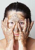 Mature woman making cosmetic mask.