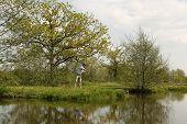 Fishermen Throws The Fishing Rod