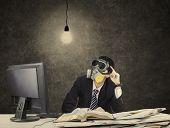 Thoughtful Businessman Wearing Gas Mask 2