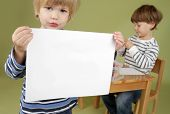 Child Holding A Blank Page Sign