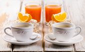 Healthy Breakfast With Two   Coffee Cup And Orange Juice