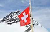 switzerland flag on Jungfrau mountain