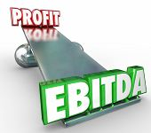 EBITDA and Profit words in 3d letters on a scale or balance to weigh the benefits of the accounting method for reporting earnings before interest, tax, depreciation and amortization