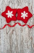 Two Red Woolen Snowflake On The Old Wood Background