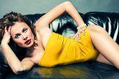 Girl In Underwear Lying On A Leather Sofa